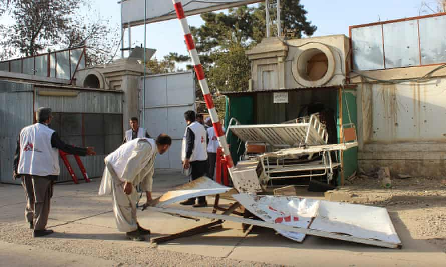 Afghan employees of the hospital move a damaged gate