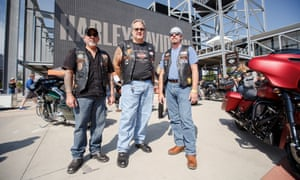 Six-String, Beer Man and Ferris stand in front of the Harley-Davidson Museum.