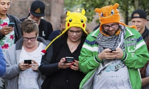 pokemon fans in hats playing pokemon go