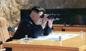Kim Jong-un studies the launch site for Tuesday's missile test.