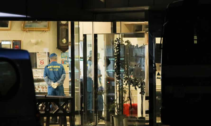 Police officers investigate after the attack at Tsukui Yamayuri En care home