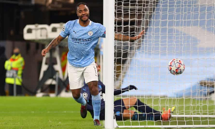 Raheem Sterling celebrates netting a late third goal in a comfortable win for Manchester City.