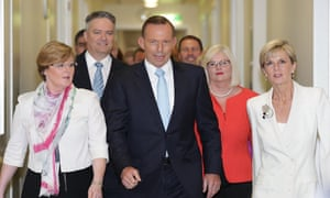 Tony Abbott on his way into the Liberal party room in Canberra on 9 February 2015, the day he faced a leadership spill motion. Thousands of miles away in Rwanda, Julia Gillard was asked: 'What is happening in your nation?'