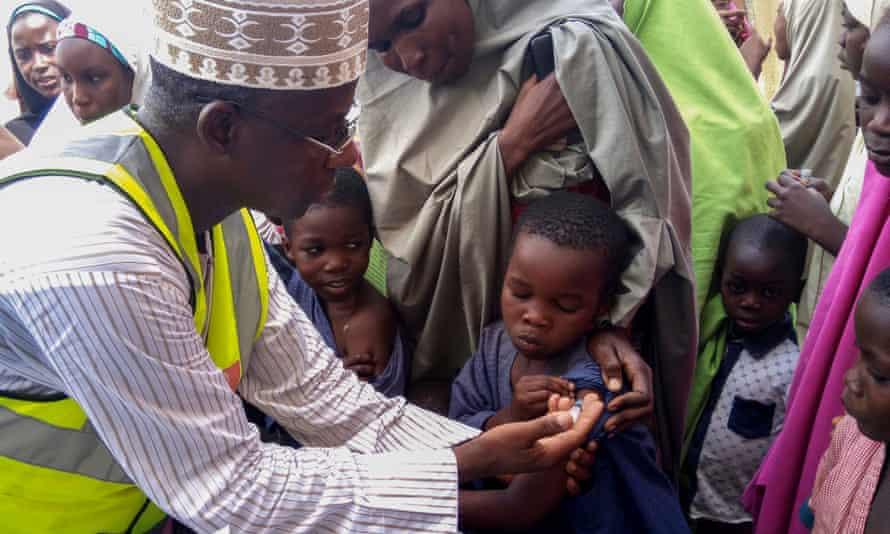 A doctor vaccinates for meningitis in Nigeria.