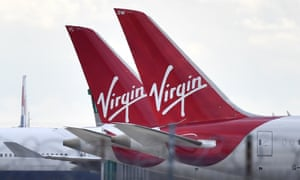 The tailfins of parked Virgin Atlantic passenger aircraft parked at Heathrow Airport.