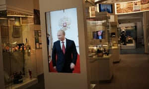 A video of Russian president Vladimir Putin is displayed at a Russian history museum in Moscow.