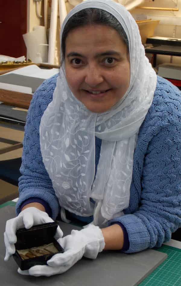 Curatorial assistant Abeer Eladany, who herself is from Egypt, with a cigar box she found at the University of Aberdeen which contained fragments of cedar wood recovered from inside the pyramid at Giza.