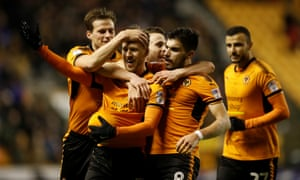 Barry Douglas sticks the ball up his shirt as he celebrates scoring Wolves' second goal in the 3-0 win against Brentford at Molineux