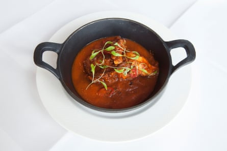 Braised Octopus, smoked chilli, white wine, garlic and tomato sauce at Smith's, Wapping, London.