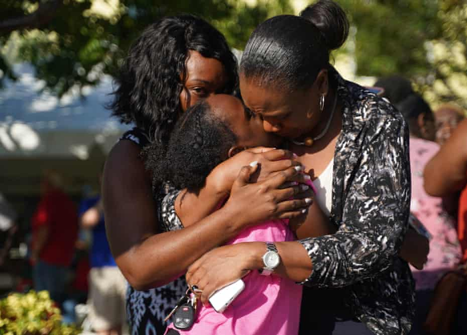 Relatives and friends greet loved ones from neighboring islands as they arrive in Nassau, Bahamas as evacuees.