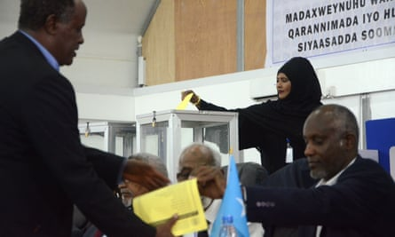 A Somali lawmaker casts her vote to elect a new president.