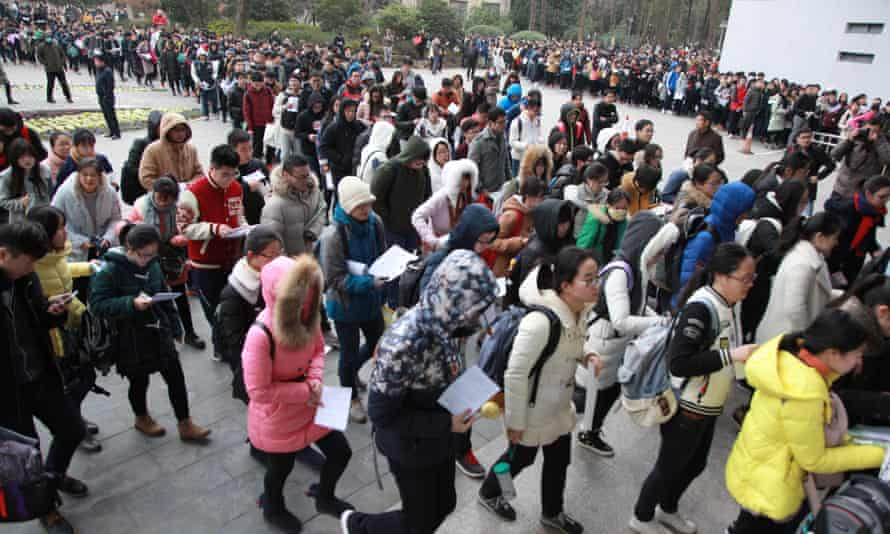 Students at Nanjing Forestry University file into a national entrance examination for postgraduate study in China's Jiangsu province