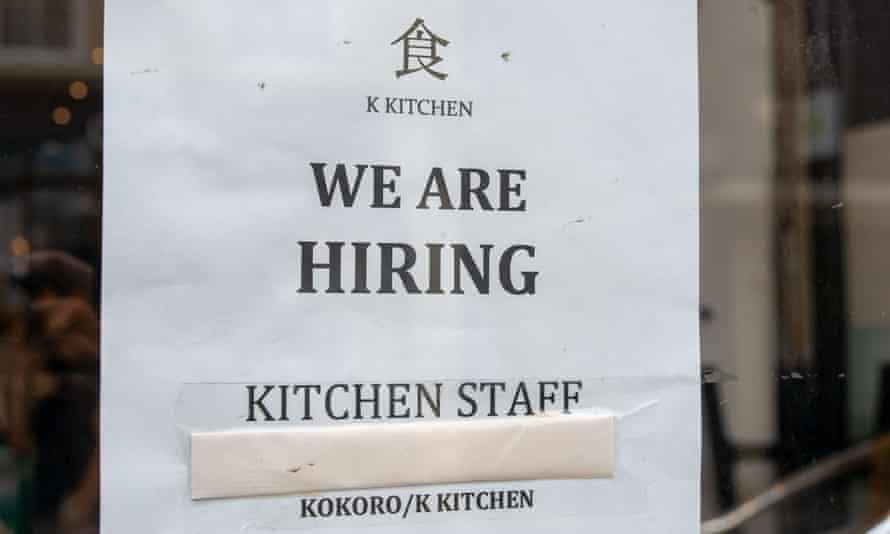 A hiring notice in a restaurant window in Windsor, Berkshire, UK.