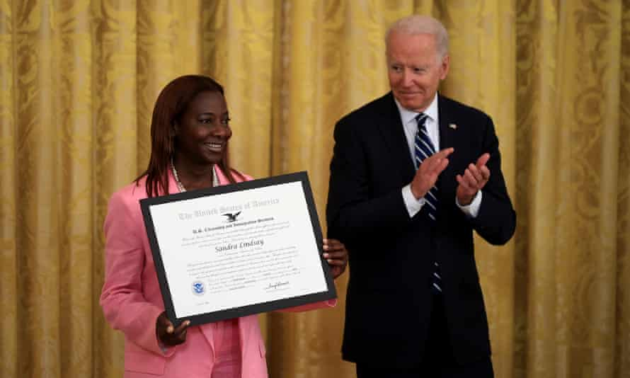 Jamaican immigrant Sandra Lindsay is presented with the US Citizenship and Immigration Services' Outstanding Citizen By Choice award by Joe Biden during a naturalization ceremony at the White House on Friday.