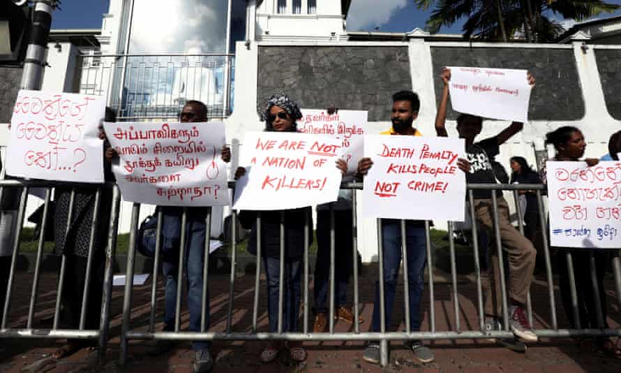 Sri Lankans protest against the death penalty in front of Welikada prison in Colombo.