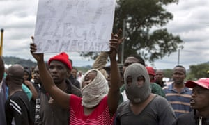 South Africans wave anti-immigration placards during a protest in Pretoria.