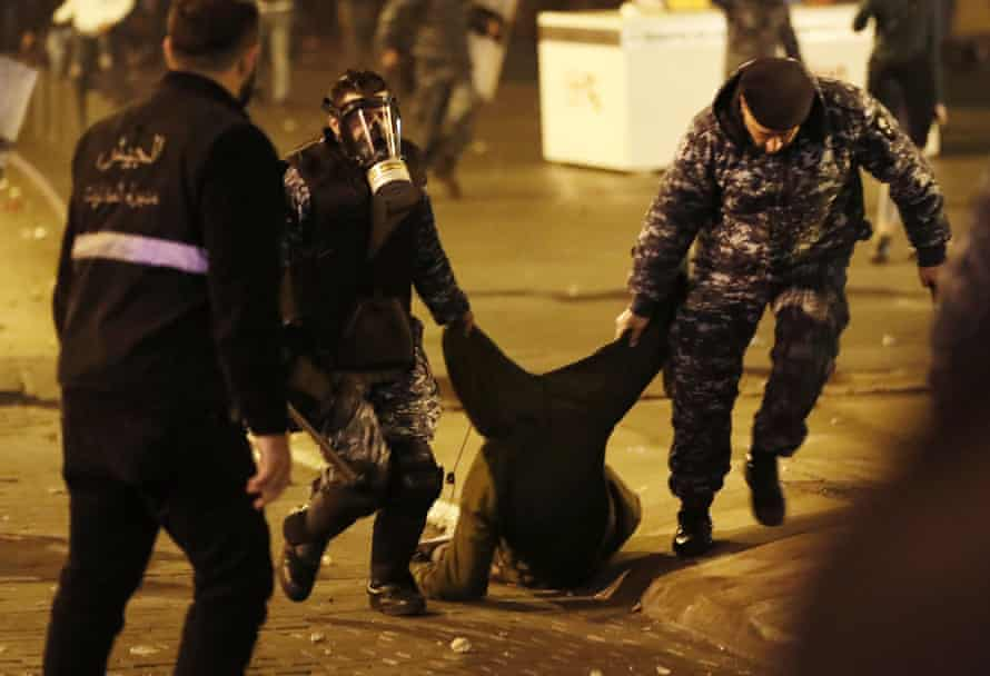 Riot police arrest an anti-government protester in Beirut.