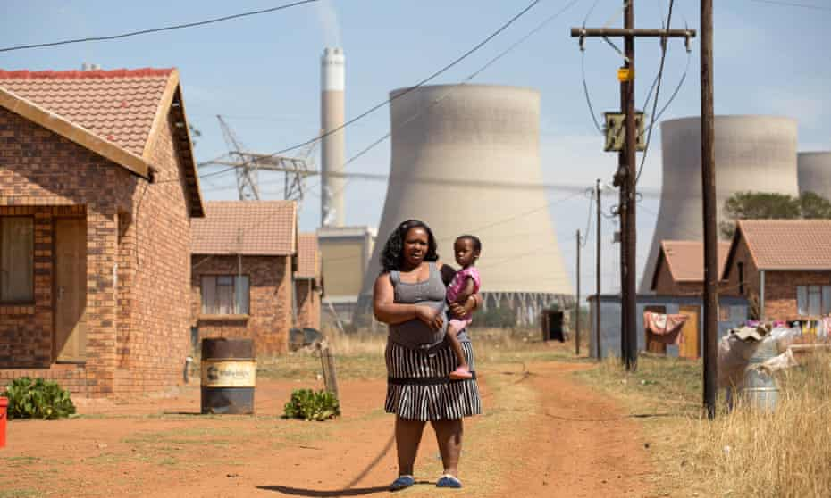 Nkosinathi Mkhwanazi and daughter Joy at the Kayalethu settlement near a power station in South Africa.