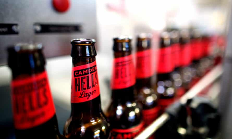 Hells Lager move along the production line inside Camden Town's brewery.