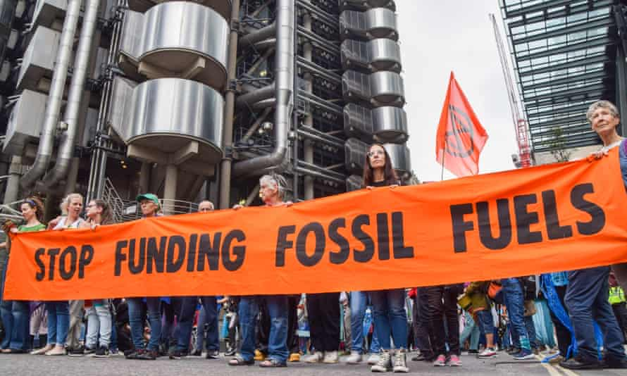 Protesters hold a 'Stop Funding Fossil Fuels' banner during the demonstration outside Lloyd's of London last week.