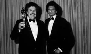 Colin Welland holding his Oscar for Chariots of Fire in 1982, with Polish author Jerzy Kosinski who presented the award.
