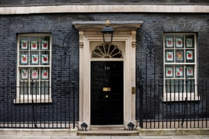 Drawings of poppies are displayed in the windows of 10 Downing Street in London