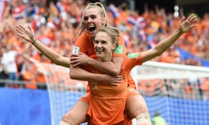 Vivianne Miedema celebrates her second goal with teammate Jill Roord.