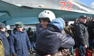A Russian air force pilot is reunited with his family in the Voronezh region as the first group of Sukhoi Su-34 fighter bombers return from Syria on 15 March 2016. Photograph: Tass/Barcroft Media