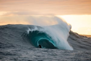 Shanan Worrall catches a smaller wave in the fading light