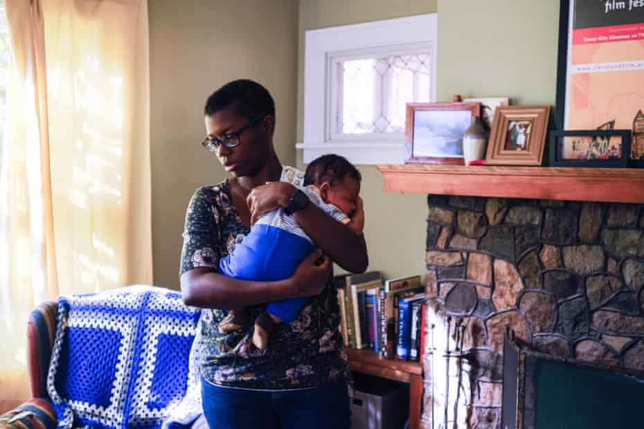 Rachel, 34, holds her son at home in Cleveland Heights, Ohio.