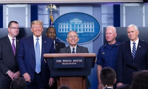 Director of the National Institute of Allergy and Infectious Diseases at the National Institutes of Health Dr. Anthony Fauci, center, joined by United States President Donald Trump and members of the Coronavirus Task Force.