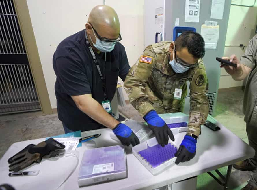 Handlers check the first shipment of the Pfizer vaccine, shortly after it arrived at Madigan Army Medical Center in Washington state.