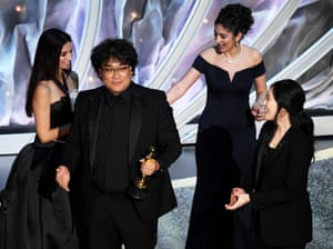 Bong Joon-ho accepts the international feature film award for Parasite.