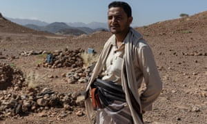 Trafficker Ahmad Dabisi in a makeshift migrant cemetery just outside Ataq, Shabwa Province, Yemen.
