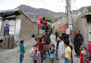 A balloon seller surrounded by children in Kabul, Afghanistan