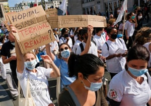 People wearing face masks carry placards during a Health Sector protest in Brussels, Belgium, on 13 September 2020. Workers, patients, caregivers and associations of the health sector united to demand the refinancing of health care and oppose the growing macro-commodification of the sector.
