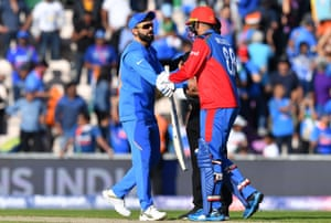 India's captain Virat Kohli (left) shakes hands with Afghanistan's Mujeeb Ur Rahman after victory.