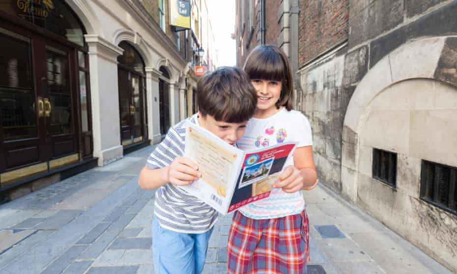 Two young children on a family Treasure Trail hunt in London.