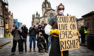 A young self-employed woman protests against the level of statutory sick pay available to self-employed and contracted workers during the coronavirus outbreak. Edinburgh, Scotland on  23 March.
