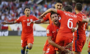 Chile's Jose Pedro Fuenzalida celebrates his goal as he jumps in the arms of Mauricio Isla.
