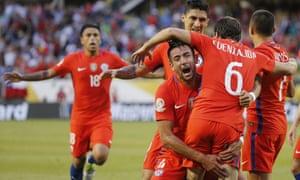 Chile's Jose Pedro Fuenzalida celebrates his goal as he jumps in the arms of Mauricio Isla.