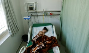 Buthaina Muhammad Mansour, believed to be four or five, lies on a bed at a hospital after she survived a Saudi-led air strike that killed eight of her family members in Sanaa, Yemen
