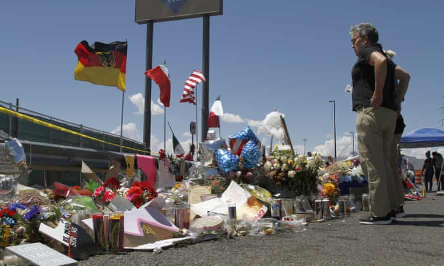 Mourners visit the makeshift memorial near the Walmart in El Paso, Texas, where 22 people were killed in a mass shooting.