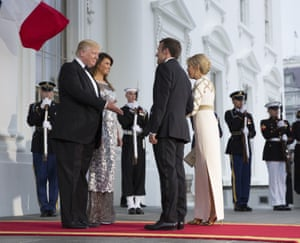 The Trumps greet the Macrons as they arrive for the state dinner