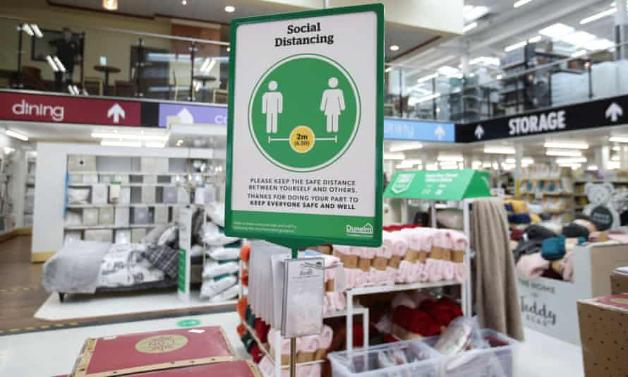 A social-distancing information sign is seen in a Dunelm store