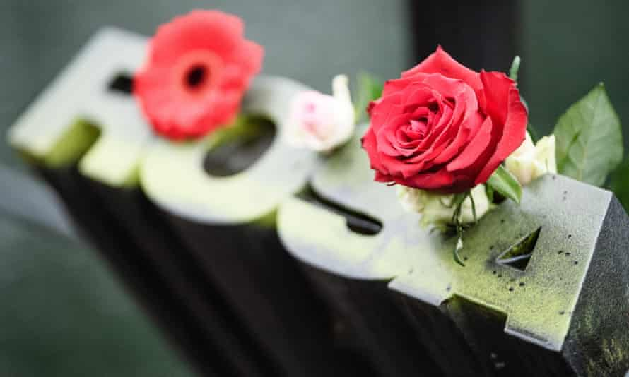 Flowers on a memorial to Rosa Luxemburg at the Tiergarten park near the river Landwehrkanalin in Berlin