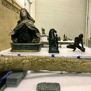 A bust of Santa Teresa of Avila from 1750 by the Spanish artist Francisco Salzillo y Alcaraz (far left) is seen in storage