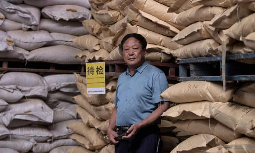 Chinese pig farmer Sun Dawu at a feed warehouse in Hebei.