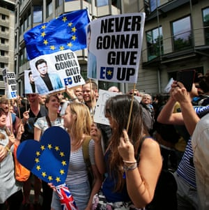 Remain supporters carry Rick Astley 'never gonna give EU up' banners