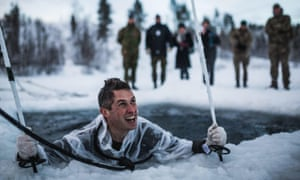 Gavin Williamson during ice breaking drills with the Royal Marines in Norway.